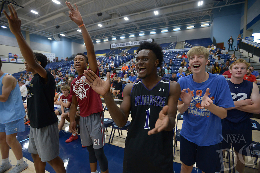 NWA Democrat-Gazette/ANDY SHUPE<br /> Austin Garrett (center) a basketball player at Fayetteville High School, cheers Tuesday, Sept. 18, 2018, with other student-athletes during the first Campaign Tipoff for the United Way of Northwest Arkansas' campaign in Wildcat Arena at Har-Ber High School in Springdale. This year's goal for the agency is approximately $1.8 million