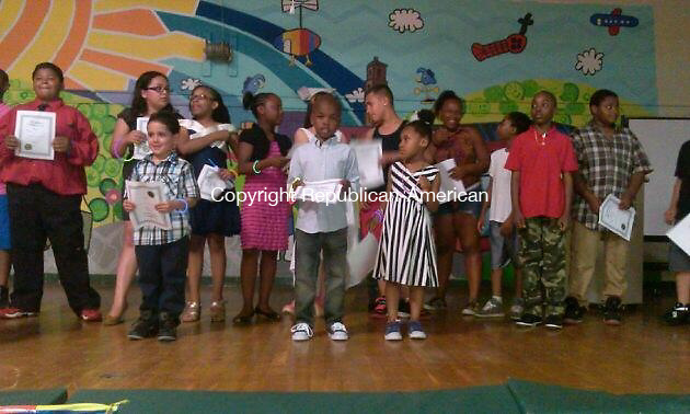 """WATERBURY -- Walsh Elementary School students participate in a """"community graduation"""" ceremony organzied by parents after school officials scaled back the school's traditional 5th grade promotional """"graduation"""" ceremonies."""