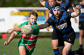 Aaron Yuill gets the pass away as Steven Jones tries to stop him. Counties Manukau Premier Club Rugby game between Onewhero and Waiuku, played at Onewhero on Saturday May 26th 2018. Onewhero won the game 24 - 20 after leading 17 - 12 at halftime. <br /> Onewhero Silver Fern Marquees 24 -Vaughan Holdt, Filipe Pau, Sean Bagshaw tries, Rhain Strang 3 conversions, Rhain Strang penalty.<br /> Waiuku Brian James Contracting 20 - Christian Walker, Fuifatu Asomua, Aaron Yuill tries, Christian Walker conversion, Christian Walker penalty .<br /> Photo by Richard Spranger.