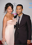 LOS ANGELES, CA. - November 21: Christine Teigen and Musician John Legend arrive at the 2010 American Music Awards held at Nokia Theatre L.A. Live on November 21, 2010 in Los Angeles, California.