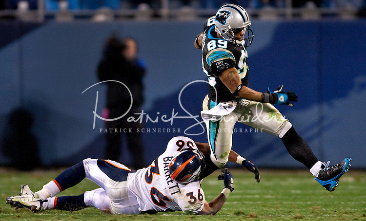 Carolina Panthers wide receiver Steve Smith (89) breaks away from Denver Broncos safety Josh Barrett (36) during an NFL football game at Bank of America Stadium in Charlotte, NC.
