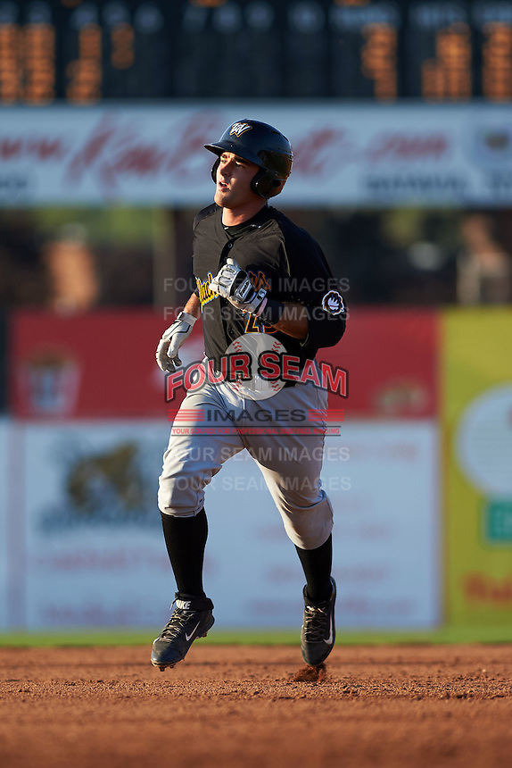 West Virginia Black Bears catcher Daniel Arribas (23) running the bases after hitting a home run during a game against the Batavia Muckdogs on August 30, 2015 at Dwyer Stadium in Batavia, New York.  Batavia defeated West Virginia 8-5.  (Mike Janes/Four Seam Images)