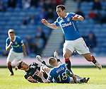 Kenny Miller tackles Kevin Moon and takes the ball away from a surprised Lee Wallace