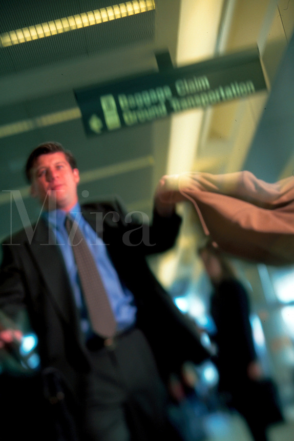 Blurred motion image of a business commuter.