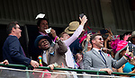 LOUISVILLE, KENTUCKY - MAY 03: Fans react to money being thrown from the roof during the undercard of the Kentucky Oaks at Churchill Downs in Louisville, Kentucky on May 03, 2019. Evers/Eclipse Sportswire/CSM