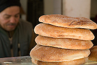 A Moroccan baker sits behind his wares, Sefrou, Morocco.