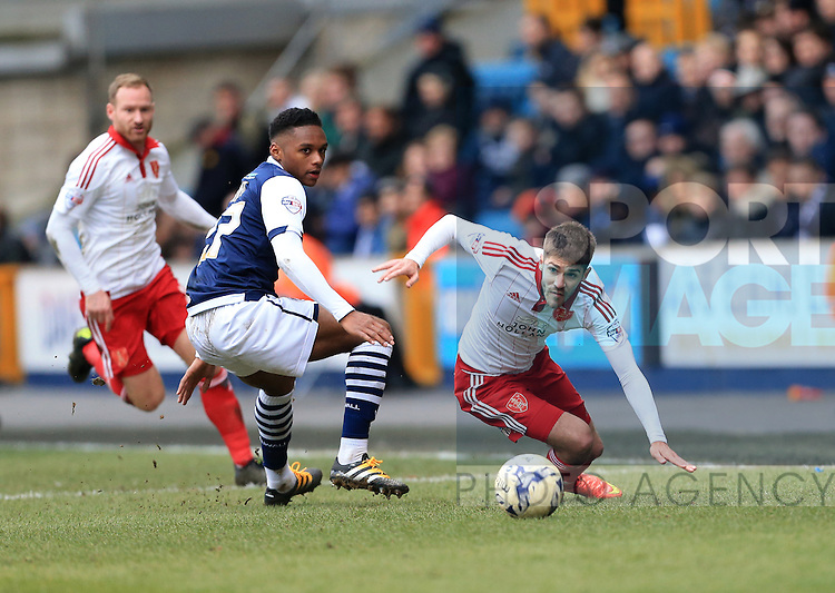 Millwall's Mahlon Romeo tussles with Sheffield United's Ryan Flynn during the League One match at The Den.  Photo credit should read: David Klein/Sportimage