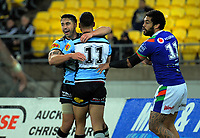 Shaun Johnson (Sharks) congratulates Briton Nikora (Sharks) on the first try during the National Rugby League match between the NZ Warriors and Cronulla Sharks at Westpac Stadium in Wellington, New Zealand on Friday, 19 July 2019. Photo: Dave Lintott / lintottphoto.co.nz
