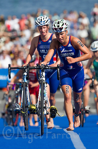 24 AUG 2013 - STOCKHOLM, SWE - Emmie Charayron (FRA) (right) of France exits transition for the start of the bike during the men's ITU 2013 World Triathlon Series round in Gamla Stan, Stockholm, Sweden (PHOTO COPYRIGHT © 2013 NIGEL FARROW, ALL RIGHTS RESERVED)