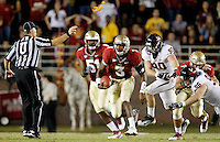 TALLAHASSEE, FL 11/19/11-FSU-UVA111911 CH-Florida State's EJ Manuel scrambles away from Virginia's Nick Jenkins as Umpire Danny Worrell throws the flag for Seminole holding during first half action Saturday at Doak Campbell Stadium in Tallahassee. .COLIN HACKLEY PHOTO