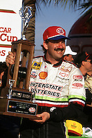 DAYTONA BEACH, FL - FEBRUARY 14: Dale Jarrett celebrates with the trophy in Victory Lane after winning the Daytona 500 NASCAR Winston Cup race at the Daytona International Speedway in Daytona Beach, Florida, on February 14, 1993.