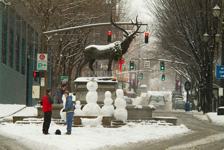The Thompson Elk Statue and Fountain on SW Main St in Snow