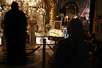 Christian worshipers pray at the Church of the Holy Sepulchre in Jerusalem's Old City, Sept. 08, 2013. The Church of the Holy Sepulchre is one of the most Holy sites in the Christian world and its site in Jerusalem is identified as the place both of the crucifixion and the tomb of Jesus of Nazareth. The church has long been a major pilgrimage center for Christians all around the world. Photo by Saeed Qaq
