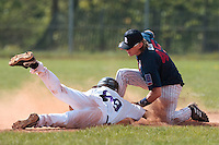 25 April 2010: Luc Piquet of Rouen tags out a PUC player at second base during game 1/week 3 of the French Elite season won 12-4 by Rouen over the PUC, at the Pershing Stadium in Vincennes, near Paris, France.