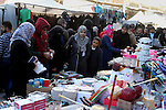 Palestinians shop at a market in Rafah in the southern of Gaza strip, on December 31, 2016. Photo by Abed Rahim Khatib