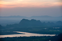 Limestone karst mountains and Thanlwin River, seen from Mount Zwegabin at sunset, Hpa An, Kayin State (Karen State), Myanmar (Burma)