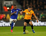 Ricardo Pereira of Leicester City chases Jonny Otto of Wolverhampton Wanderers during the Premier League match at Molineux, Wolverhampton. Picture date: 14th February 2020. Picture credit should read: Darren Staples/Sportimage