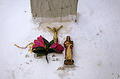 Sao Paulo, Brazil. Typical religious display on a white wall (cross, Jesus, flowers).