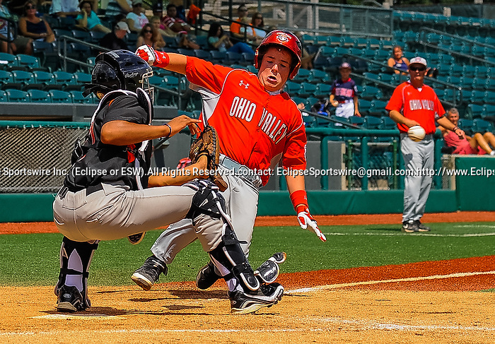 Mattoon(IL)'s Garrette Branson is tagged at the plate by Bronx(NY)'s Javier Rosario during the Cal Ripken Babe Ruth World Series in Aberdeen, Maryland on August 12, 2012