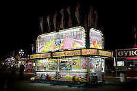 View of a food vendor stand selling cotton candy, candy apple, sno kones and popcorn at the North Carolina State Fair in Raleigh, NC, United States, 16 October 2008.