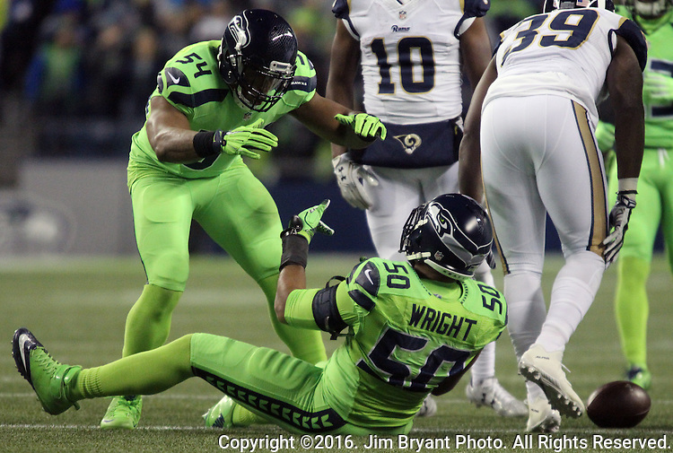 Seattle Seahawks middle linebacker Bobby Wagner (54) celebrates defensive end Frank Clark (55) after Clark tackled Los Angeles Rams running back Malcolm Brown (39) behind the line of scrimmage for a loss at CenturyLink Field in Seattle, Washington on December 15, 2016.  The Seahawks beat the Rams 24-3.  ©2016. Jim Bryant Photo. All Rights Reserved
