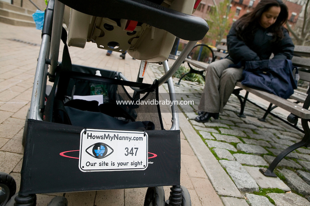 22 November 2006 - New York City, NY - View of a stroller carrying a Howsmynanny.com number plate in a park in New York City, USA, 22 November 2006. The plate allows people to report any good or bad behaviour by the nanny to the website which then relays it to the parents.