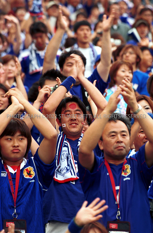 6/4/2002--Saitama, Japan..Japan fans before the  2002 World Cup Group H match Japan vs Belgium in Saitama, Japan. The match ended 2-2. The other teams playing in Group H are Russia and Tunisia. ...All photographs ©2003 Stuart Isett.All rights reserved.This image may not be reproduced without expressed written permission from Stuart Isett.