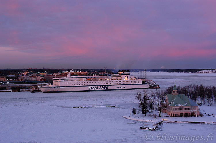 Silja Finnjet in Helsinki harbour at winter sunset.