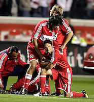 Chicago Fire defender Wilman Conde (22) consoles a dejected John Thorrington (11) after the Fire loss.  Thorrington was one of three Fire players who failed to convert their penalty kicks.  Real Salt Lake defeated the Chicago Fire in a penalty kick shootout 0-0 (5-4 PK) in the Eastern Conference Final at Toyota Park in Bridgeview, IL on November 14, 2009.