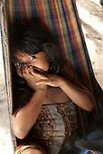 Aldeia Baú, Para State, Brazil. Panho-roti Kayapo, an indigenous girl, lying in a hammock.