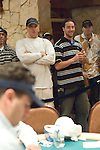 Michael and Eric Mizrachi watch big brother, Robert-foreground, compete.