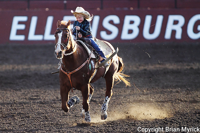 Five-year-old Kassidy Bremner competes in the barrel racing event during the Daily Record Bares and Broncs Futurity at the Ellensburg Arena, Saturday, May 12, 2012. (Brian Myrick / Daily Record)