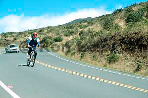 Bicycling down Haleakala volcano, follow-van behind, Maui, Hawaii
