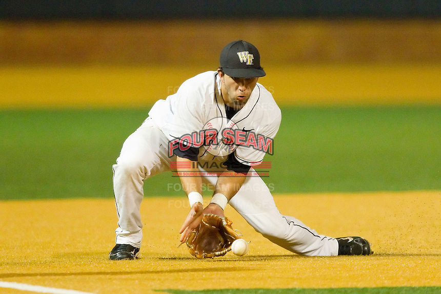 Third baseman Carlos Lopez #3 of the Wake Forest Demon Deacons fields a ground ball during the game against the Charlotte 49ers at Gene Hooks Field on March 22, 2011 in Winston-Salem, North Carolina.  Photo by Brian Westerholt / Four Seam Images