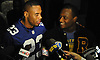 New York Giants running back Rashad Jennings talks to the media after presenting Roosevelt High School senior Chukwuma Ukwu, right, with the Heart of a Giant Award in the school's auditorium on Tuesday, Dec. 15, 2015. Ukwu, who played on Roosevelt's varsity football team, was honored for his dedication on the gridiron and exceptional service to his local community.