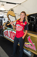 Sep 23, 2016; Madison, IL, USA; NHRA driver Leah Pritchett, pilot of the Papa Johns Pizza sponsored top fuel dragster of Don Schumacher Racing poses for a portrait in her pit area next to the logo of the St Louis Cardinals baseball team on the side of her car during qualifying for the Midwest Nationals at Gateway Motorsports Park. Mandatory Credit: Mark J. Rebilas-USA TODAY Sports