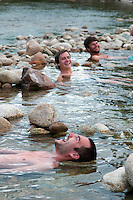 Lobios. Peneda Geres National Park, Portugal, June 2011. Hikers relax their muscles in the hot springs on Lobios on the Spanish border. In the extreme North of Portugal, between the Atlantic Coast and the Spanish border are the mountains and valleys of Peneda Geres National Park. Walk along narrow shepherd trails or on the ancient cement of Roman roads. From lush river valleys to bare rocky mountain peaks.  Photo by Frits Meyst/Adventure4ever.com