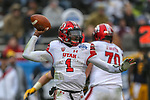 Utah Utes quarterback Tyler Huntley (1) in action during the Zaxby's Heart of Dallas Bowl game between the Utah Utes vs. West Virginia Mountaineers at the Cotton Bowl Stadium in Dallas, Texas.