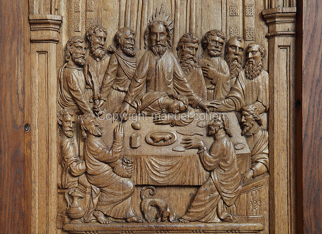Detail of a wood relief of the Last Supper from the canons' stalls, 13th century, made for the choir but moved to the sacristy in 1935, in the Cathedrale Saint-Julien du Mans or Cathedral of St Julian of Le Mans, Le Mans, Sarthe, Loire, France. The cathedral was built from the 6th to the 14th centuries, with both Romanesque and High Gothic elements. It is dedicated to St Julian of Le Mans, the city's first bishop, who established Christianity in the area in the 4th century AD. Picture by Manuel Cohen