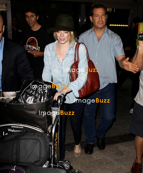 Emma Stone arrives at the International Los Angeles airport..Los Angeles, October 5, 2012.