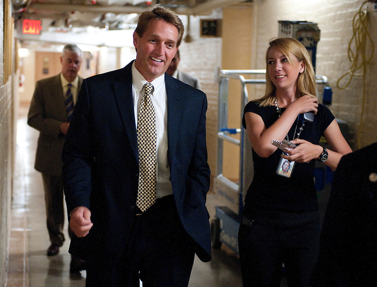 UNITED STATES - JULY 29: Rep. Jeff Flake, R-Ariz., arrives the House Republicans' caucus meeting in the basement of the Capitol on Friday, July 29, 2011. (Photo By Bill Clark/Roll Call)