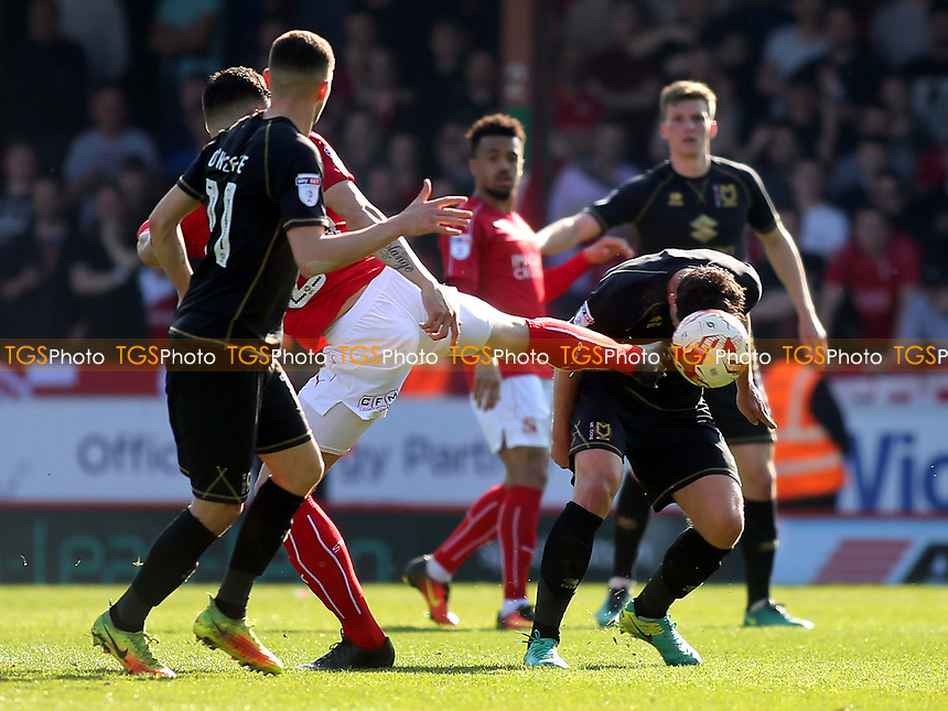 Joe Walsh of MK Dons bravely bends down to head the ball during Swindon Town vs MK Dons, Sky Bet EFL League 1 Football at the County Ground on 8th April 2017