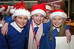 Zaklin Basta, Ella Murphy and Chloe O'Brien at the Christmas Carol Singing with Mell National School...Photo NEWSFILE/Jenny Matthews.(Photo credit should read Jenny Matthews/NEWSFILE)....This Picture has been sent you under the condtions enclosed by:.Newsfile Ltd..The Studio,.Millmount Abbey,.Drogheda,.Co Meath..Ireland..Tel: +353(0)41-9871240.Fax: +353(0)41-9871260.GSM: +353(0)86-2500958.email: pictures@newsfile.ie.www.newsfile.ie.FTP: 193.120.102.198.