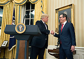 United States President Donald Trump shakes hands with Steven Munchin before he was sworn-in as Treasury Secretary during a ceremony at the White House in Washington, D.C. on February 13, 2017. Mnuchin was confirmed by the Senate 54-47 earlier today. <br /> Credit: Kevin Dietsch / Pool via CNP