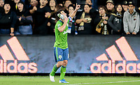 LOS ANGELES, CA - OCTOBER 29: Nicolas Lodeiro #10 of the Seattle Sounders FC scores a goal and celebrates with his shoe phone during a game between Seattle Sounders FC and Los Angeles FC at Banc of California Stadium on October 29, 2019 in Los Angeles, California.