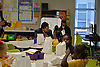 Superintendent Richard Carranza serves breakfast to second-graders at Codwell ES.