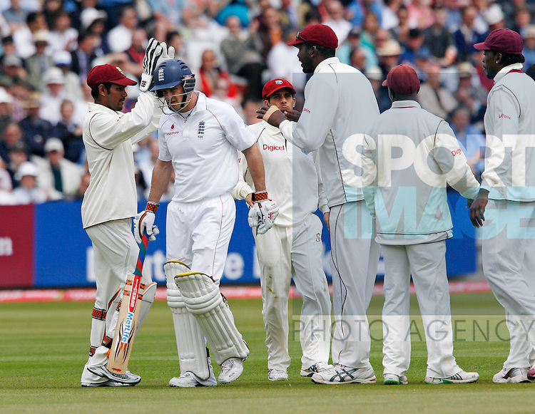 England's Andrew Strauss looks on dejected after getting out for 16 bowled by West Indies' Jerome Taylor and caught by Denesh Ramdin