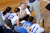 22 November 2008:  New Orleans Volleyball Head Coach Jozsef Forman speaks with his players during a time-out in the WKU 3-0 victory over New Orleans in the championship game of the Sun Belt Conference tournament at U.S. Century Bank Arena in Miami, Florida.