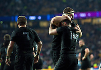 Nehe Milner-Skudder of New Zealand is congratulated on his try by team-mate Brodie Retallick. Rugby World Cup Final between New Zealand and Australia on October 31, 2015 at Twickenham Stadium in London, England. Photo by: Patrick Khachfe / Onside Images