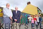 Local artist Jim Dunne withTady Hunt, president of Athea Tidy Towns, pictured with community volunteers and a mural showing aspects of life in Athea Village, pictured here last Friday morning.